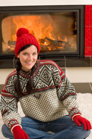 Happy woman warming up by home fireplace wear Christmas sweater Stock Photo - 11476292