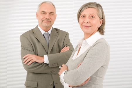 Professional elegant smiling senior businesspeople standing with cross arms photo