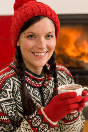 Winter christmas woman with hat and gloves drink by fireplace Stock Photo - 11464650