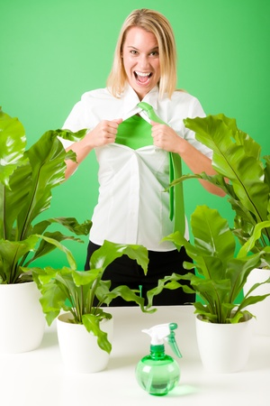 undressing: Green business superhero woman crazy shouting plants environment friendly