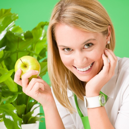 environment friendly: Green business office woman smiling hold apple plant environment friendly Stock Photo