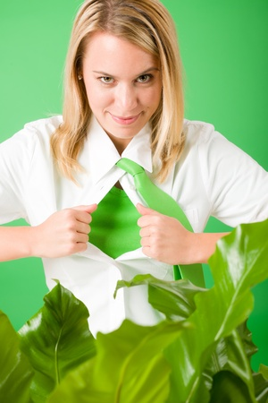 Superhero Businesswoman confident face green plants emerges from shirt