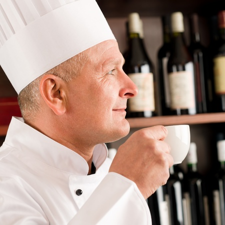 Chef cook relax break enjoy cup of coffee in restaurant photo