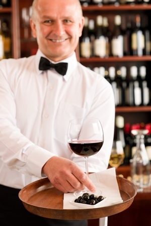 Wine bar waiter mature serving on tray glass olives restaurant Stock Photo - 11851134