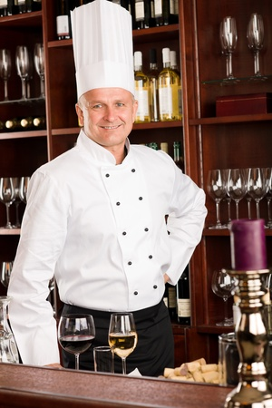 Chef cook wine bar professional standing confident in restaurant photo