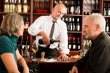Wine bar senior couple enjoy drink professional barman pour glass Stock Photo - 11916108