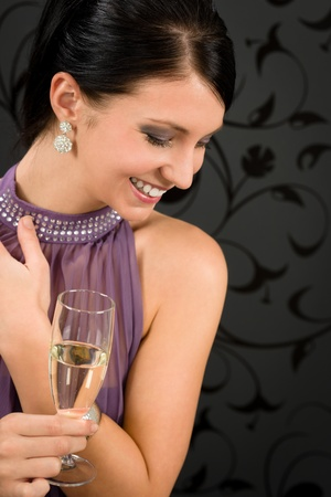 Woman party dress drink champagne glass glamorous look aside photo