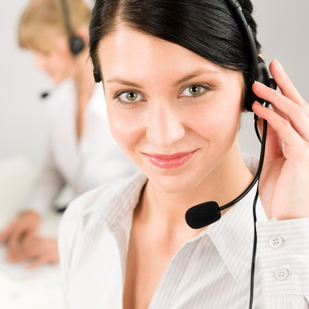 call center female: Customer service team woman call center smiling operator phone headset