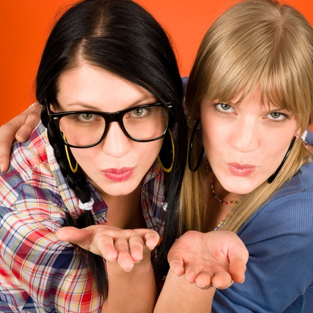 Two woman friends young sending kisses smiling crazy outfit Stock Photo - 11950882