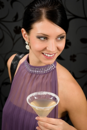 Woman party dress hold cocktail glass smiling look aside photo