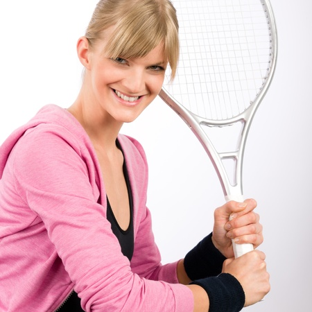 Tennis player woman young smiling serving racket isolated photo