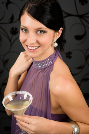 Woman party dress hold cocktail glass smiling look at camera photo