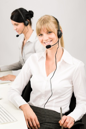 Customer service team woman call center smiling operator phone headset Stock Photo - 12029416