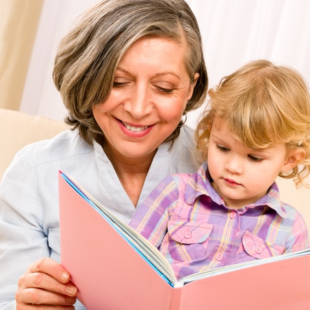 two story: Grandmother and little girl reading book happy together at home