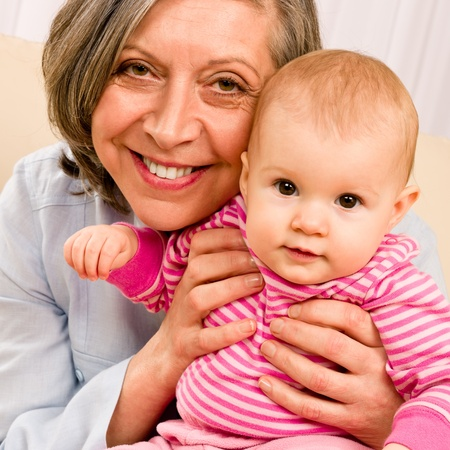Senior woman hold little baby girl cute smiling close-up Stock Photo - 12079920