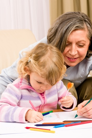 Grandmother and granddaughter drawing together with pencils Stock Photo - 12079929