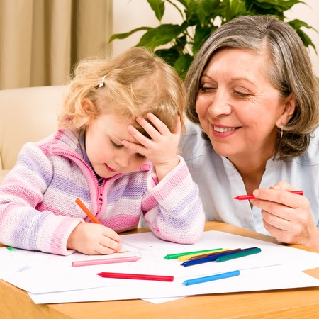Grandmother and granddaughter drawing together with pencils at home Stock Photo - 12079937