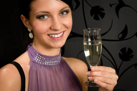 party outfit: Woman party dress toasting champagne glass drink glamorous look camera Stock Photo