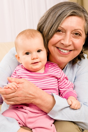 Senior woman hold little baby girl cute smiling close-up Stock Photo - 12343477