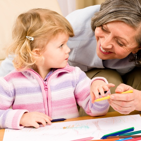 Grandmother and granddaughter drawing together with pencils at home Stock Photo - 12343472
