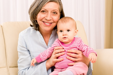 Senior woman hold little baby girl cute smiling close-up Stock Photo - 12343446
