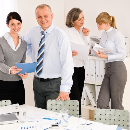 new strategy: Sales meeting business people review reports consulting new strategy