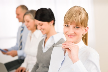 applicant: Young businesswoman smiling meeting with team colleagues