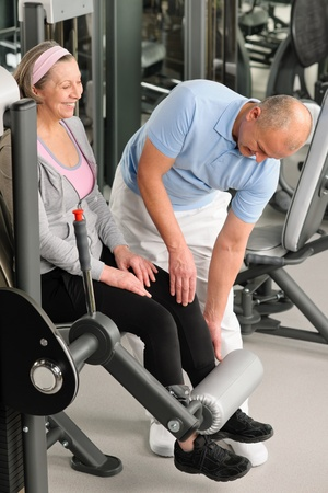Physical therapist male assist active senior woman exercise at gym Stock Photo - 12343683