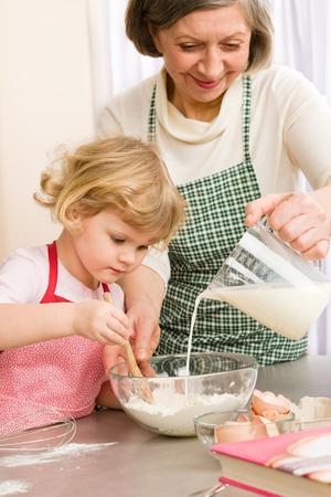Grandmother and granddaughter baking cookies prepare dough Stock Photo - 12757701