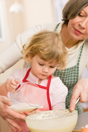 Grandmother and granddaughter baking cookies prepare dough Stock Photo - 12757514