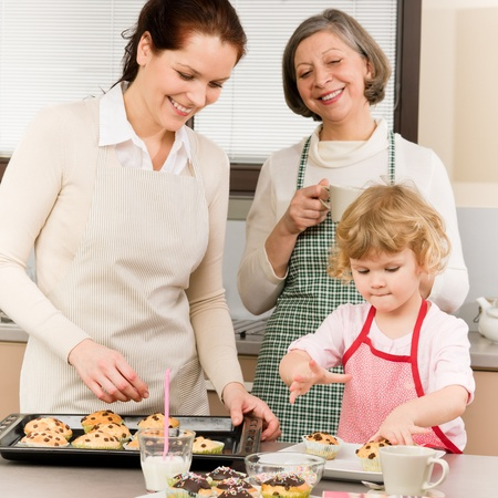 Grandmother, mother and child girl making cupcakes in kitchen Stock Photo - 12757836