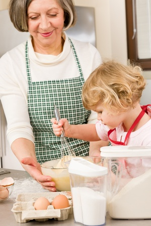 Grandmother and granddaughter baking cookies prepare dough Stock Photo - 12758194