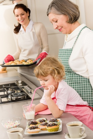 Family women baking cupcakes in kitchen grandmother, mother and granddaughter Stock Photo - 12758212