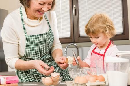 Grandmother and granddaughter baking cookies prepare dough Stock Photo - 12756923