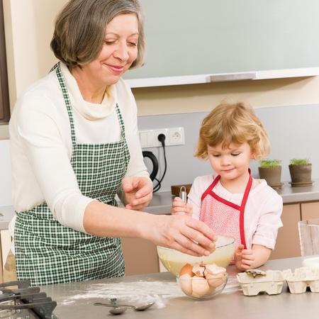 Grandmother and granddaughter baking cookies prepare dough Stock Photo - 12758244