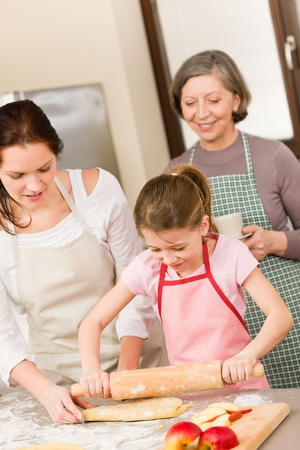 Mother and daughter making apple pie together grandmother check recipe Stock Photo - 12756908