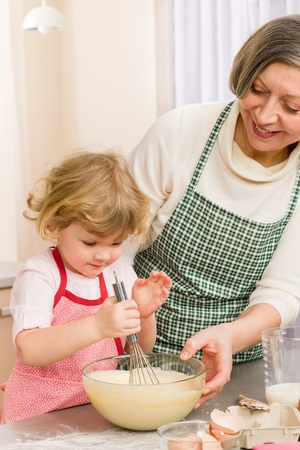 Grandmother and granddaughter baking cookies prepare dough Stock Photo - 12758331