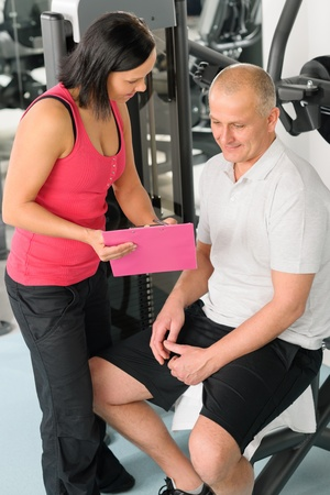 Fitness center personal plan happy active man with trainer photo