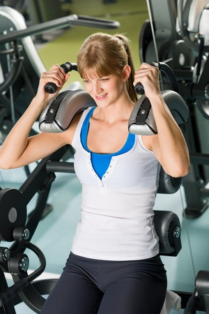 Fitness center young woman exercise abdominal muscles on gym machine Stock Photo - 12909861