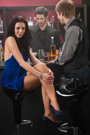 woman bar: At the bar attractive young woman wear blue dress