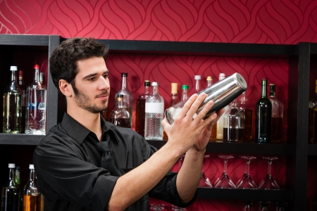 Handsome barman professional at posh bar making cocktail drinks Stock Photo - 12910107
