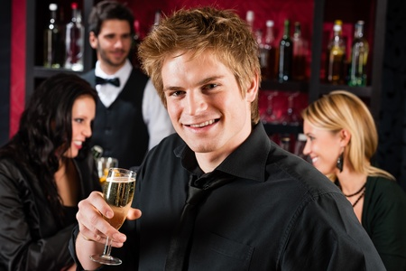 Handsome man toasting champagne with his friends at the bar Stock Photo - 12910128