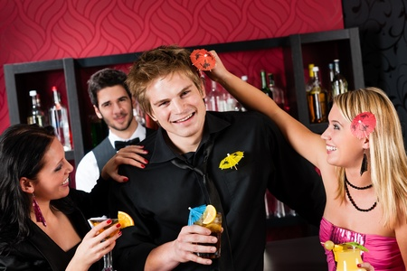 Friends drinking at cocktail bar during happy hours have fun Stock Photo - 12910127