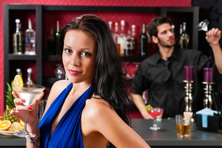 provocative women: Attractive young woman at cocktail bar enjoy drink from bartender