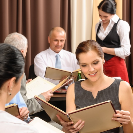 order: Business lunch executive people looking menu  ordering meal at restaurant Stock Photo
