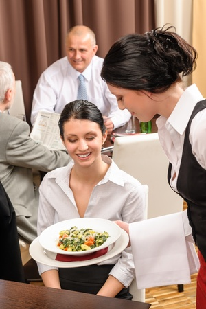 Business lunch young businesswoman being served by a waitress Stock Photo - 13125649
