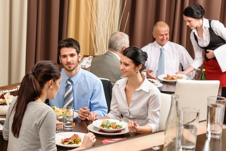 lunch meeting: Business people enjoy lunch meal at restaurant management discussion