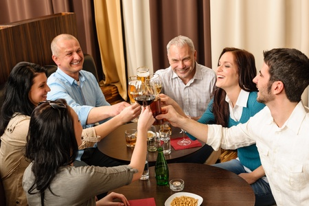 social gathering: Drink after work business people toasting at restaurant have fun
