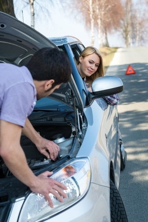 Car troubles couple starting broken vehicle on the road Stock Photo - 13125667