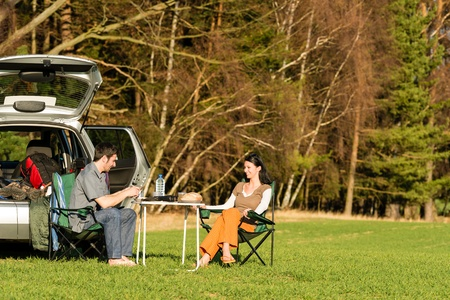 Camping car happy young couple enjoy picnic sunny countryside Stock Photo - 13125676